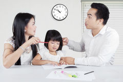 Couple arguing in front of their kid Stock Photography