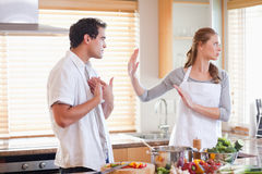 Couple arguing in the kitchen Stock Images