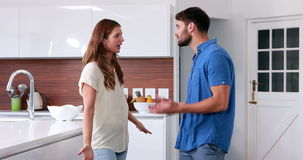 Couple arguing in the kitchen. At home stock video