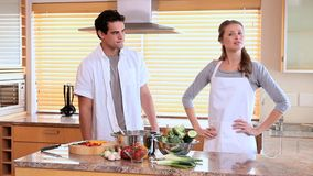 Couple arguing in the kitchen. Young couple arguing in the kitchen stock footage