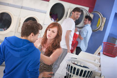 Couple Arguing In Laundromat Royalty Free Stock Photo