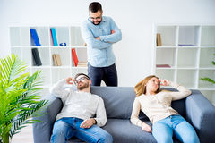 Couple arguing in a marriage counseling. Couple arguing and breaking up in a marriage counseling and driving therapist crazy Royalty Free Stock Photography