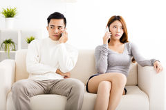 Couple arguing  on the mobile  phones Royalty Free Stock Images