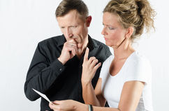 Couple arguing about money on bill Stock Image