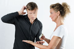 Couple arguing about money on her hand Royalty Free Stock Image