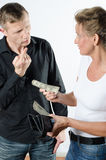 Couple arguing about money in wallet Stock Images