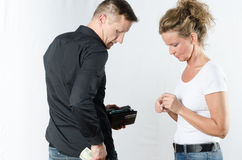 Couple arguing about money in wallet and pocket Stock Photos