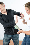 Couple arguing about money in wallet and pocket Royalty Free Stock Photos