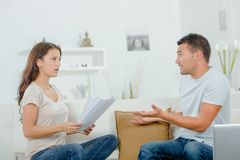 Couple arguing over bills royalty free stock photo