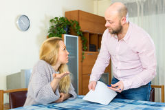 Couple arguing over a questionnaire. Couple a men and a women arguing on how they should fill in a questionnaire Royalty Free Stock Image