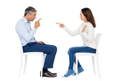 Couple arguing while sitting Stock Images
