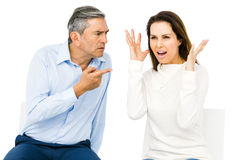 Couple arguing while sitting Royalty Free Stock Images