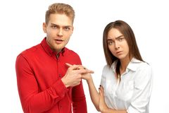 Couple arguing and swearing with the indignant persons showing each other the index finger. stock photos