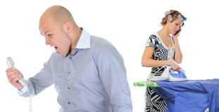Couple is arguing while talking over the telephone Stock Photography