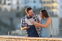 Couple arguing about travel destination on vacation royalty free stock photography