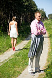 Couple arguing during a walk stock images