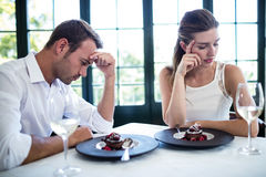 Couple into an argument on a date. In a restaurant Royalty Free Stock Photography