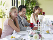 Couple With Arm Around At Dinner Party Royalty Free Stock Image
