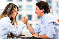 Couple arm wrestling Stock Images