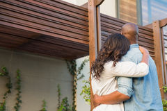 Couple with arms above after buying house. Back view of couple with arms above after buying house Stock Photos