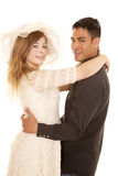 Couple arms around each other both look smile Stock Image