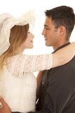 Couple arms around each other close look into eyes Stock Photography