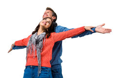 Couple with arms outstretched Royalty Free Stock Images