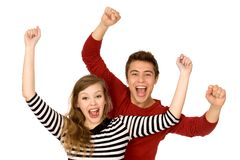 Couple with arms raised Royalty Free Stock Images