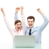 Couple with arms raised Stock Photo