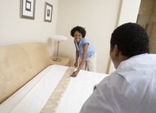 Couple Arranging Bed Royalty Free Stock Photography