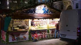 Couple arranging for Christmas Market visitors stalls before inauguration. STRASBOURG, FRANCE - CIRCA 2018: Couple arranging the Christmas market stalls with stock footage