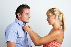 Couple, arranging each others clothing Stock Photos