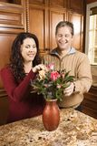 Couple arranging flowers. Royalty Free Stock Photos