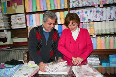 A couple arranging their product Stock Image
