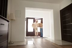 Couple arrived at new house with cardboard boxes royalty free stock images