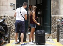 A couple arrives with the suitcases at a hotel. To spend the holidays  in Palma de Mallorca, in the Balearic Islands of Spain.  During a summer with many Royalty Free Stock Images