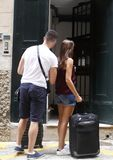 A couple arrives with the suitcases at a hotel Royalty Free Stock Images