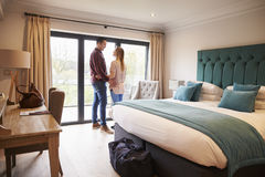 Couple Arriving In Hotel Room On Vacation Royalty Free Stock Images