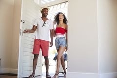 Couple Arriving At Summer Vacation Rental stock image