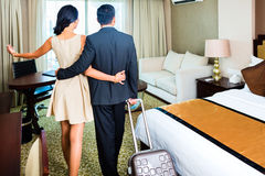 Couple arriving to hotel room Royalty Free Stock Photo