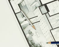 Couple of artistic drawing pencils on authentic real estate floor plan graphic material Royalty Free Stock Photos