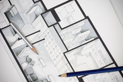 Couple of artistic writing drawing tools shot on regular real estate floor plan showing luxurious approach to interior home design Stock Images