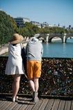 Couple in the Arts bridge in Paris Royalty Free Stock Photo