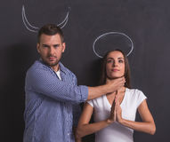 Couple as angel and demon Royalty Free Stock Photos