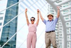 Couple of Asian old man and woman tourist are acting as exciting and very happy. This photo also contain concept of good life of stock photography