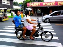 Couple of asian women riding a motorcycle Royalty Free Stock Photos