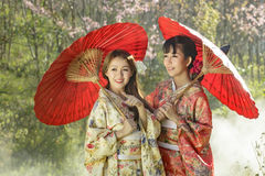 Couple asian women wearing traditional japanese kimono and red u