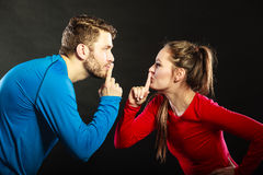 Couple asking for silence with finger gesture. Royalty Free Stock Photos