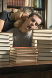 Couple Asleep on Books - Vertical. Stock Images