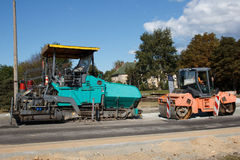 A couple of asphalt paving machines Royalty Free Stock Photography